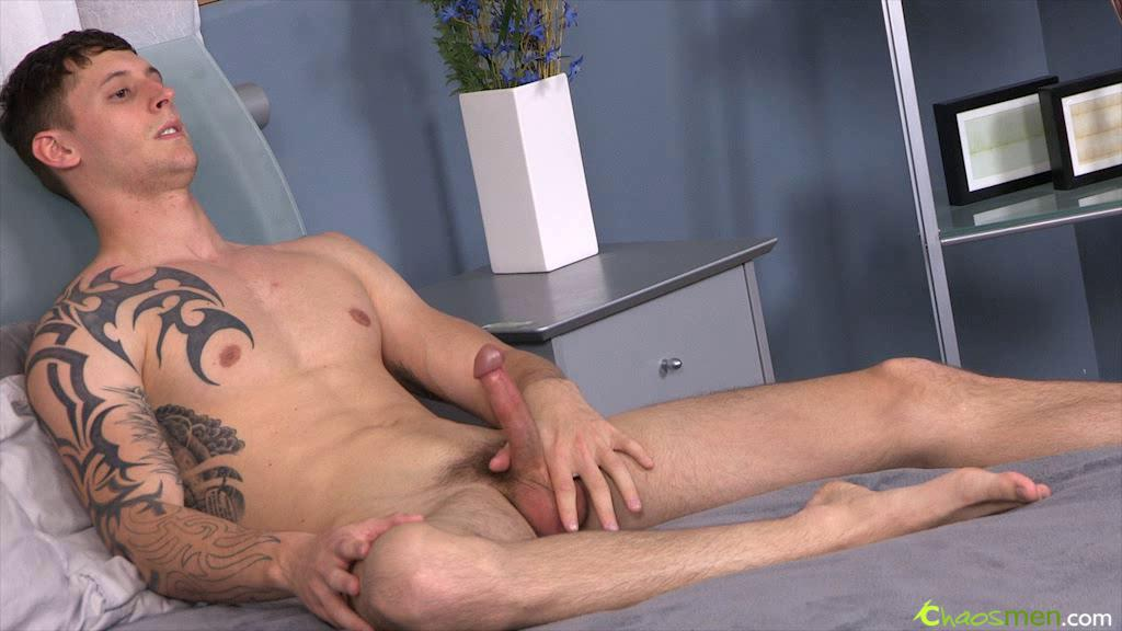 Tattooed fellow is relaxing by wanking his knob