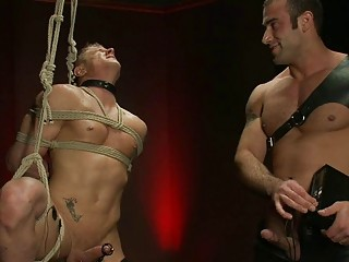 Dark haired homo hunk dominates over bound humiliated blond hunk