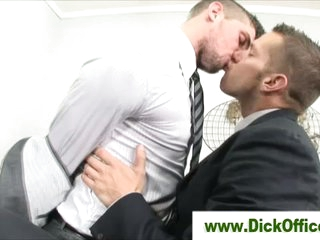 2 homo businessmen french giving a kiss