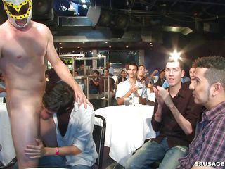 A homosexual male stripper with a luchador mask is having his ramrod sucked by a multitude of homosexual men and getting kissed. Who will begin to get fucked and in which way will they bone every others? How will their party end?