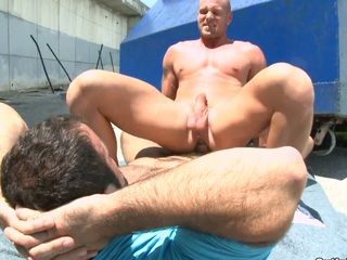 A man with beard fucking his hairless boyfriend in the face hole and ass.